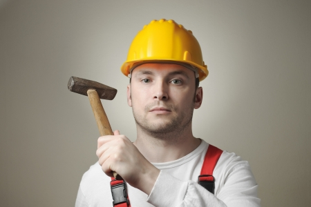 maintenance fitter: Young worker with a hammer
