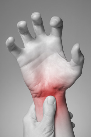 A young woman massaging her painful wrist
