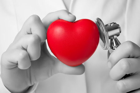 Red heart shape and stethoscope in a doctor Stock Photo