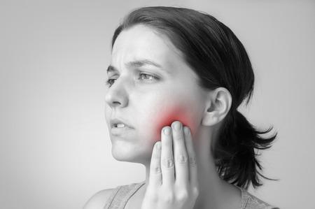 Young woman having toothache Standard-Bild