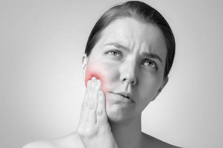 Young woman having toothache Stock Photo
