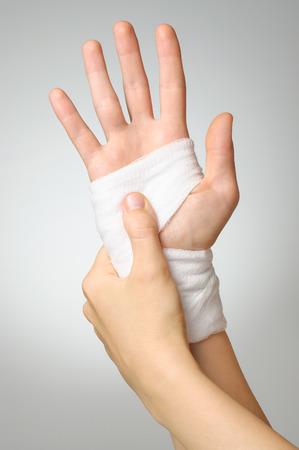 gauze: Injured painful hand with white bandage