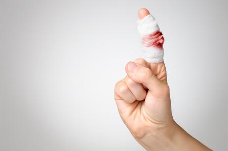 Injured finger with bloody gauze bandage Foto de archivo