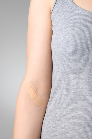 body wound: Female arm with adhesive bandage