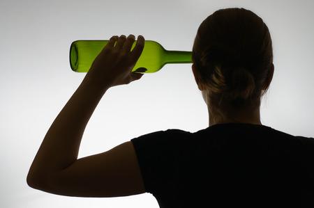 anonym: Silhouette of an alcoholic woman with a bottle