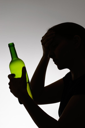 anonym: Silhouette of a sad drinker