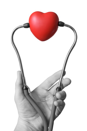 check up: Male hand holding a red heart and stethoscope Stock Photo