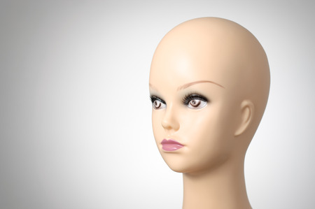 mannequin head: Mannequin head on grey background with copyspace Stock Photo