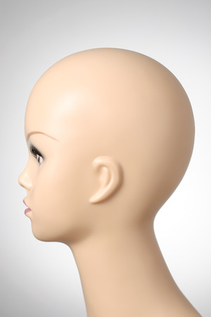 bald girl: Closeup of a female mannequin head Stock Photo