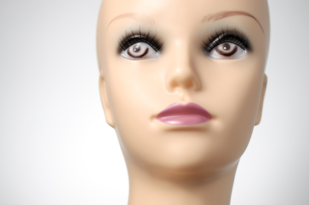 bald girl: Closeup of mannequin head on grey background