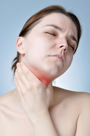 Young woman holding her painful neck photo