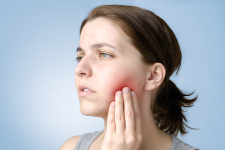 Young woman suffering from toothache photo