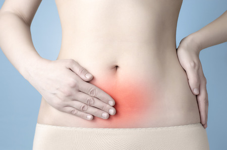 Young woman having stomach ache photo