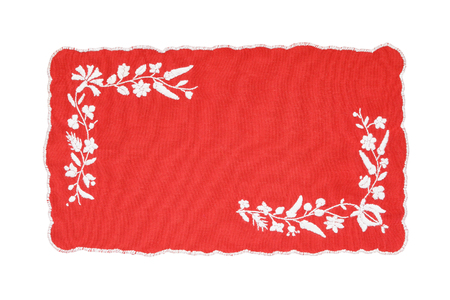 Embroidered red and white tablecloth isolated on white background Stock Photo