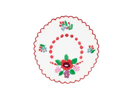 Embroidered tablecloth with floral motives isolated on white background