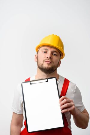 Worker holding blank clipboard on white background