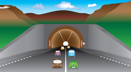 Tunnel in mountains. Highway and cars before an tunnel. Two lanes road and various vehicles, mountains and tunnel. Autobahn exit from underground mountain tunnel. Average car traffic on the highway.
