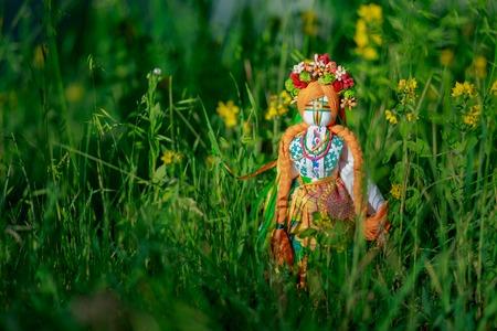 Ukrainian doll-motanka or rag doll.  Handmade textile doll ancient culture folk crafts tradition of Ukraine. Stock Photo