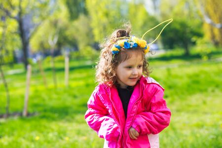 Kids in bunny ears and rabbit costume. Toddler kid play outdoor. Stock Photo