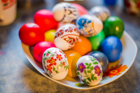 Kyiv / Ukraine - 04 16 17: Plate with colorful Easter eggs. Easter eggs on the Easter table. Eggs with painted plastic stickers Stock Photo