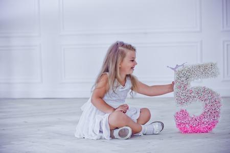 child celebrates 5th birthday. girl is upset matured. child mischievous and indulges Stock Photo