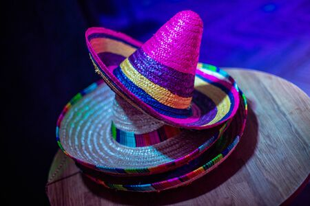 Mexican sombrero hat in the decor of the hall for the holiday. Mexican style party. Reklamní fotografie