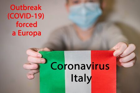 Text Coronavirus Italy. Outbreak COVID-19 forced a Europa Novel Coronavirus outbreak concept. Coronavirus protective breathing mask on boy.