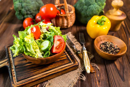 Healthy vegetable salad of fresh tomato, cucumber, and greens on plate. Diet menu.