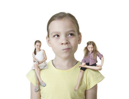 Little girl makes a choice between two of his characters without background Stock Photo