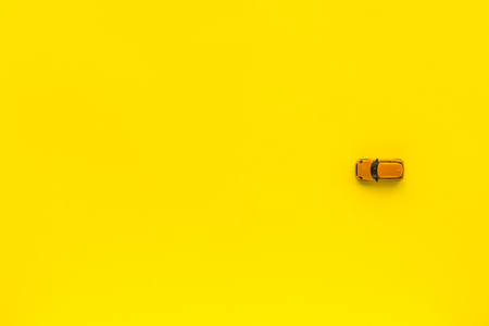 Little Yellow toy car on a yellow background. Free space for text Stock Photo