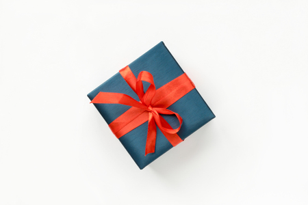 Blue Gift box with red ribbon on white background. Top view. Copyspace Standard-Bild
