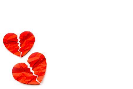 Two Red paper broken hearts on white background. Love concept. Divorce 版權商用圖片