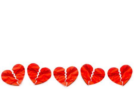 Border of many Red paper broken hearts on white background. Love concept. Divorce. 版權商用圖片