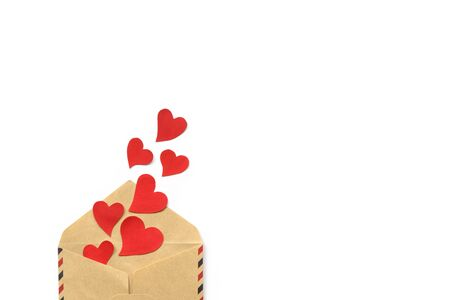 Valentines day, red hearts from the craft envelope isolated on white background. Love concept. Copyspace