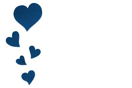 Valentines Day card background, classic blue cute hearts made of paper. White background with hearts in paper cut in different size. Valentine Day romantic. Copyspace