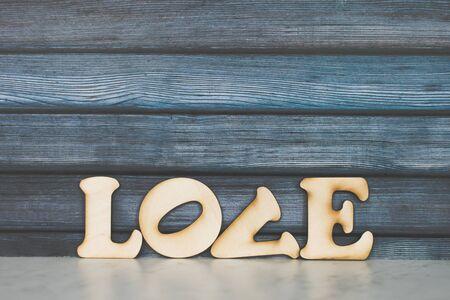 Valentines Day card background. Decorative wooden word on dark background. Valentine Day. Love concept. Copyspace 版權商用圖片
