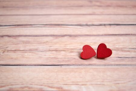 Valentines day card with red hearts on a wooden background, love message. Love concept. Romantic.