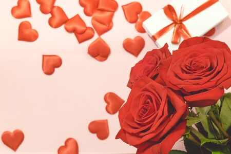 Valentines day background,Red rose with red hearts and gift box on pink background,For card and wedding background 版權商用圖片
