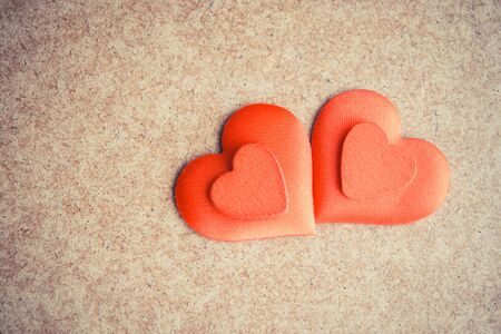 Two Red hearts on the wooden desk background. Copyspace 版權商用圖片