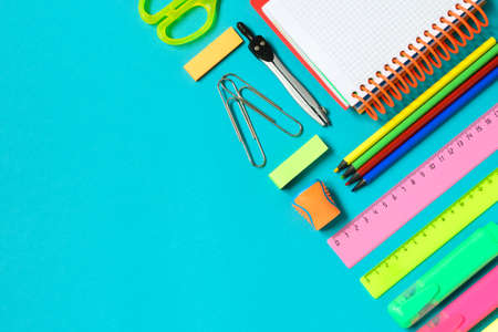 School or office supplies on light blue background. Free space for text