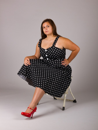 Beautiful Curvy Teenage Girl in White and Black Polkadot Dress with Red Shoes