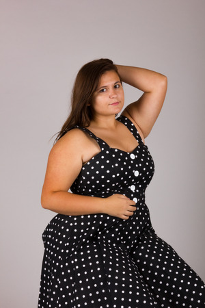 f68859c0885fc Beautiful Curvy Teenage Girl in Polkadot Dress and Black Shoes