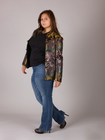 Beautiful Curvy Teenage Girl in Black Shirt and Jeans Archivio Fotografico