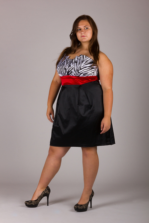 Beautiful Curvy Teenage Girl in White and Black Striped Dress with Black Shoes