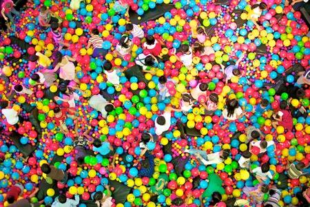 kids playing colorful ball photo