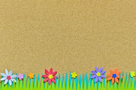 cork board with colorful graphic flower and grass Stock Photo