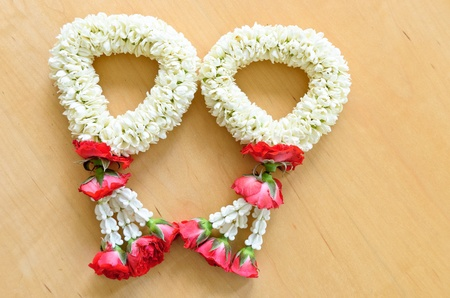 pair of thai style garland on wood background