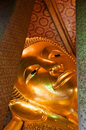 reclining golden buddha face Stock Photo
