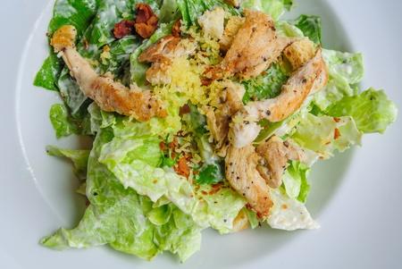 roast chicken salad in white plate