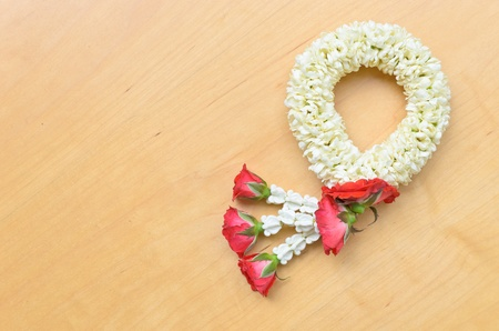 thai style garland on wood background